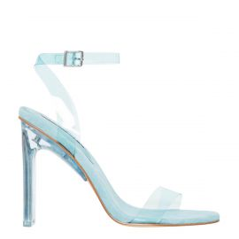 Women's blue perspex upper high heel with suede lining and ankle buckle strap. Fancy Blue by Windsor Smith. Side view.