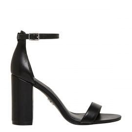 Side view of Indie, black high heel with closed back and ankle strap.