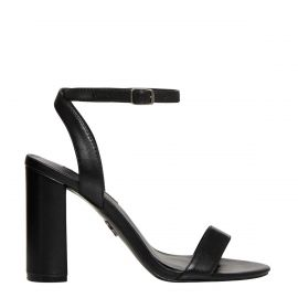 Side view of black high heel sandal with an ankle strap.